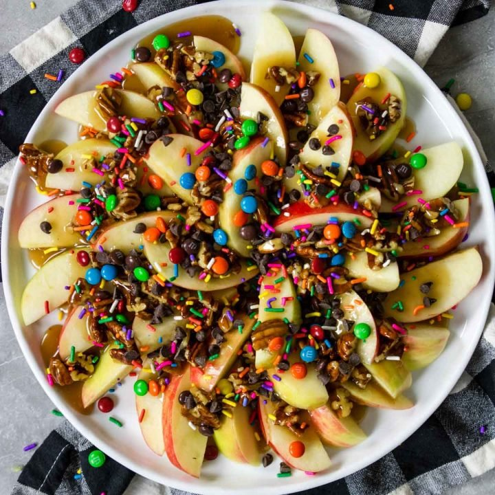 apple nachos with caramel m&m's, sprinkles and chocolate chips