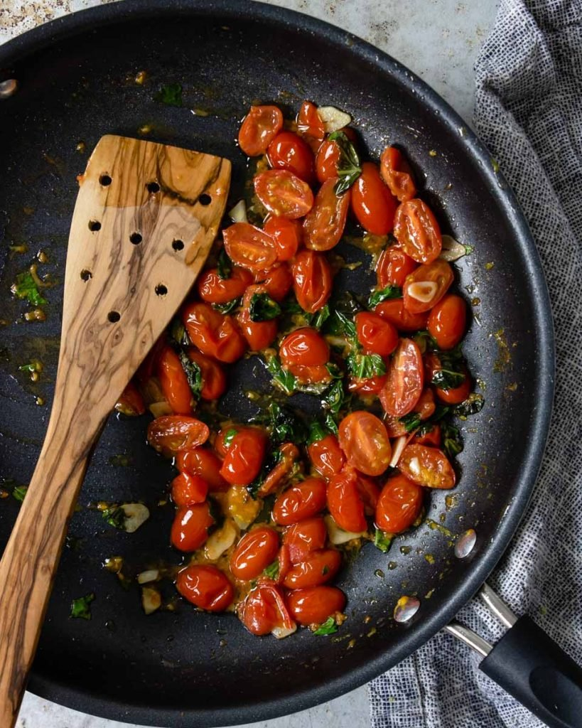 tomato garlic and basil in a skillet