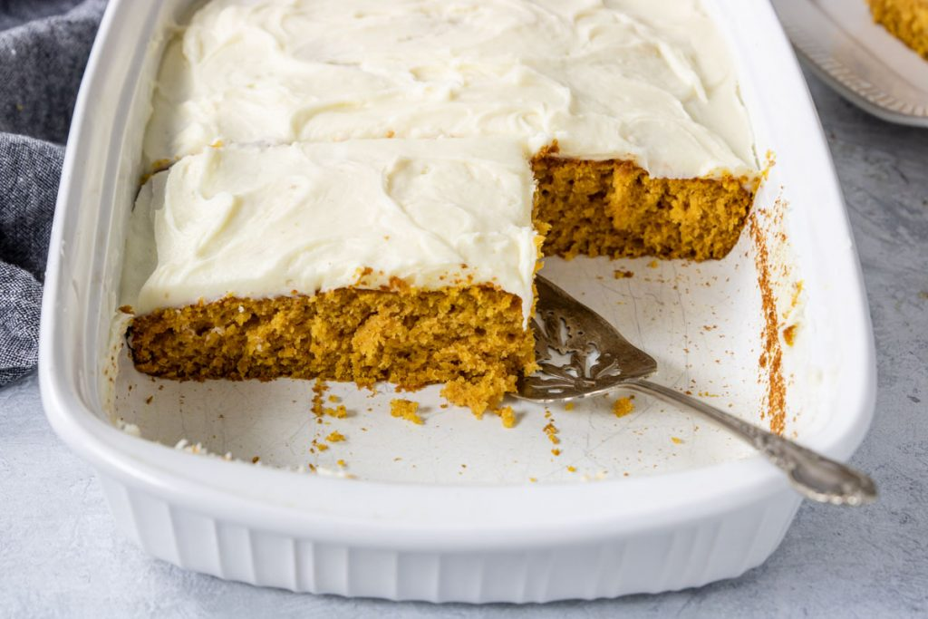 pumpkin cake topped with frosting