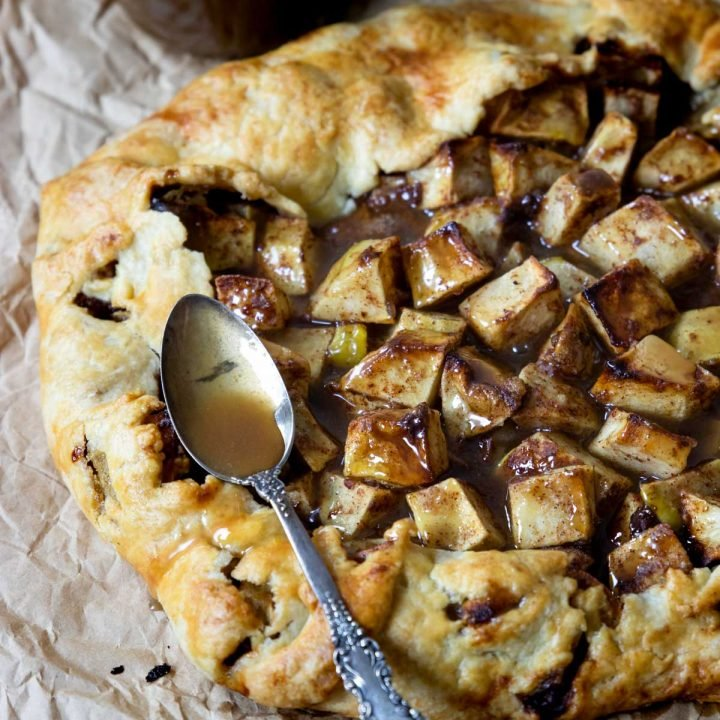 apple crostata with a spoonful of caramel