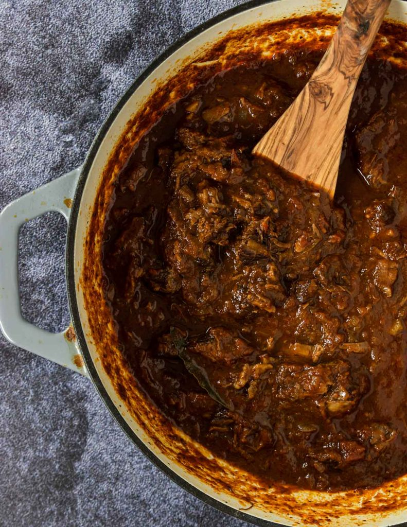 A pot of rich and hearty beef ragu made with wine