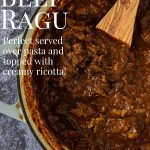 Beef Ragu in a large pot with a wooden spoon