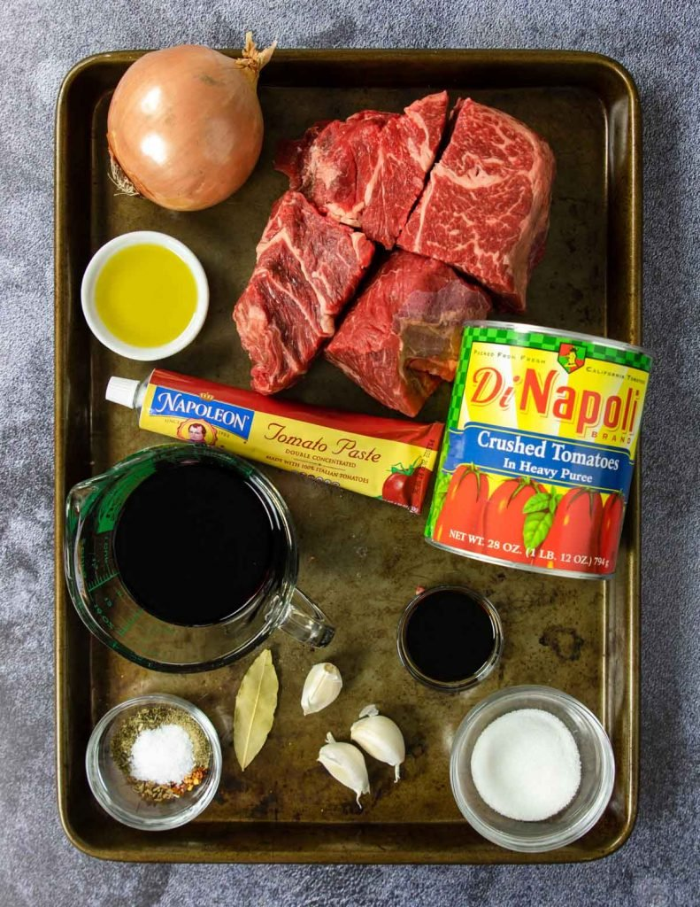 beef ragu ingredients on a tray