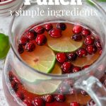 cranberry punch in a pitcher with pinterest text