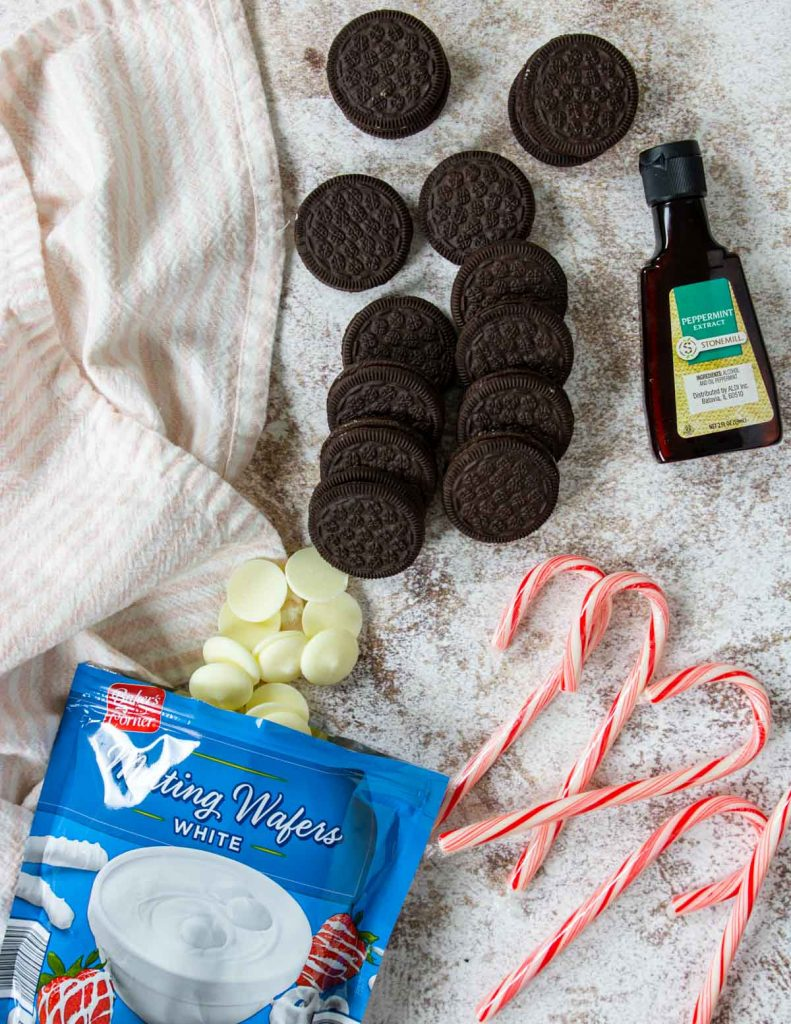 4 ingredients laid out to make peppermint bark oreos