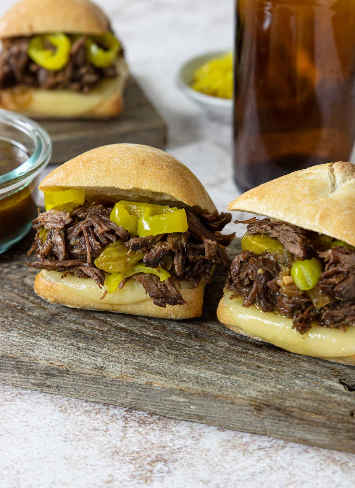 Italian Beef Sandwiches piled high with shredded beef and pepperoncinis