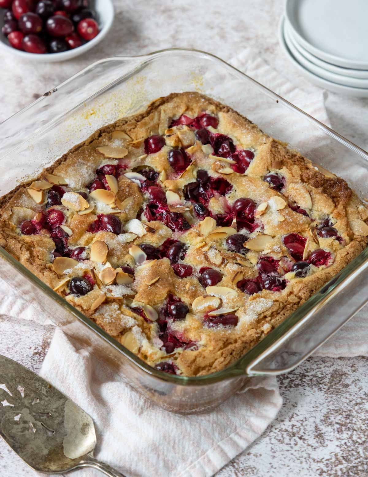 Cranberry Almond Cake in an 8x8 glass baking dish