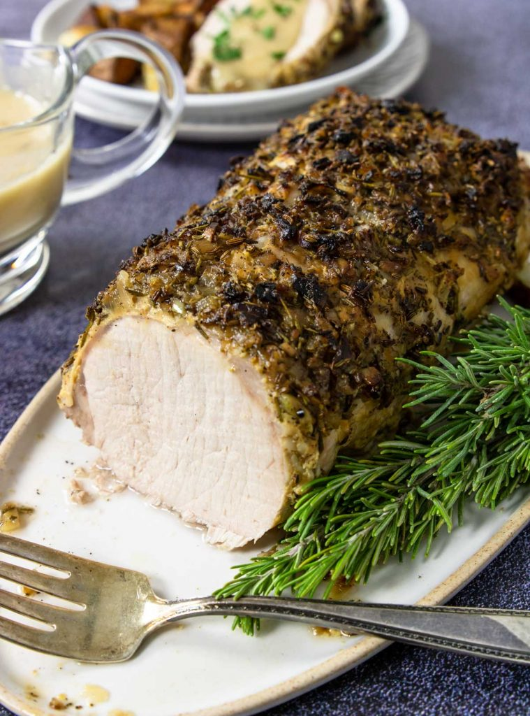 roasted pork loin topped with a garlic and rosemary mixture