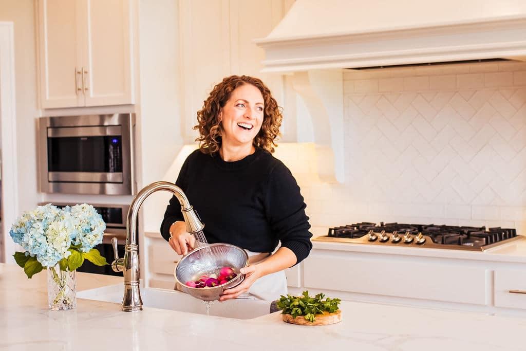 Susie Weinrich washing produce
