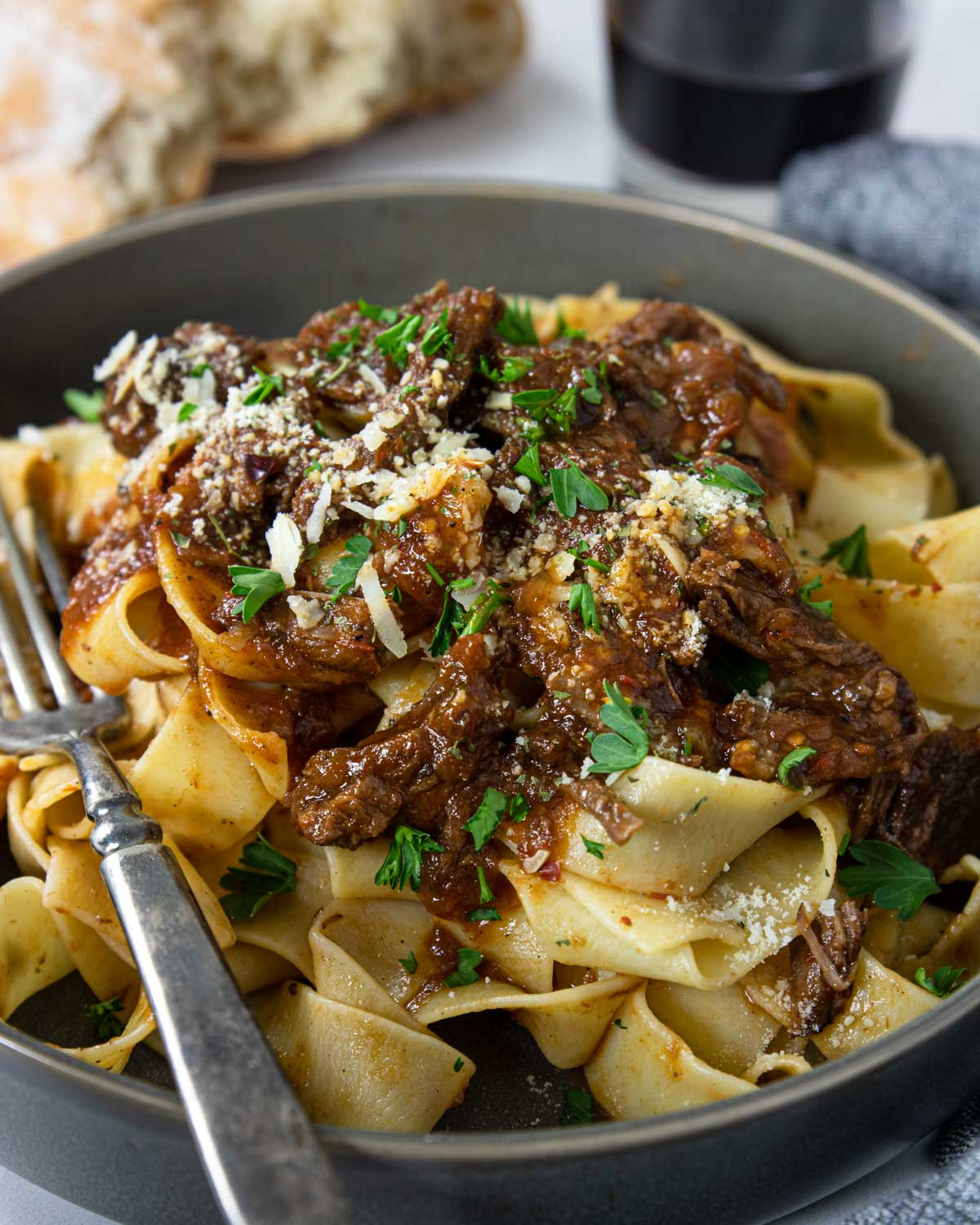shredded beef ragu poured over cooked pasta