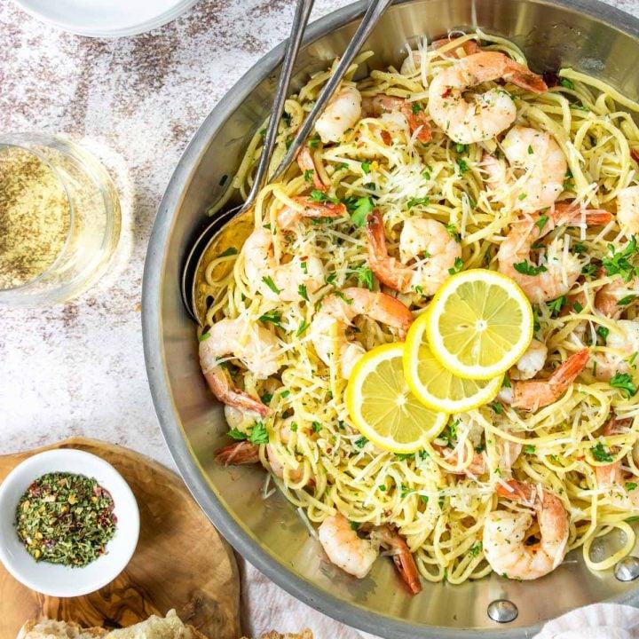 linguine with shrimp and lemons in a sauté pan