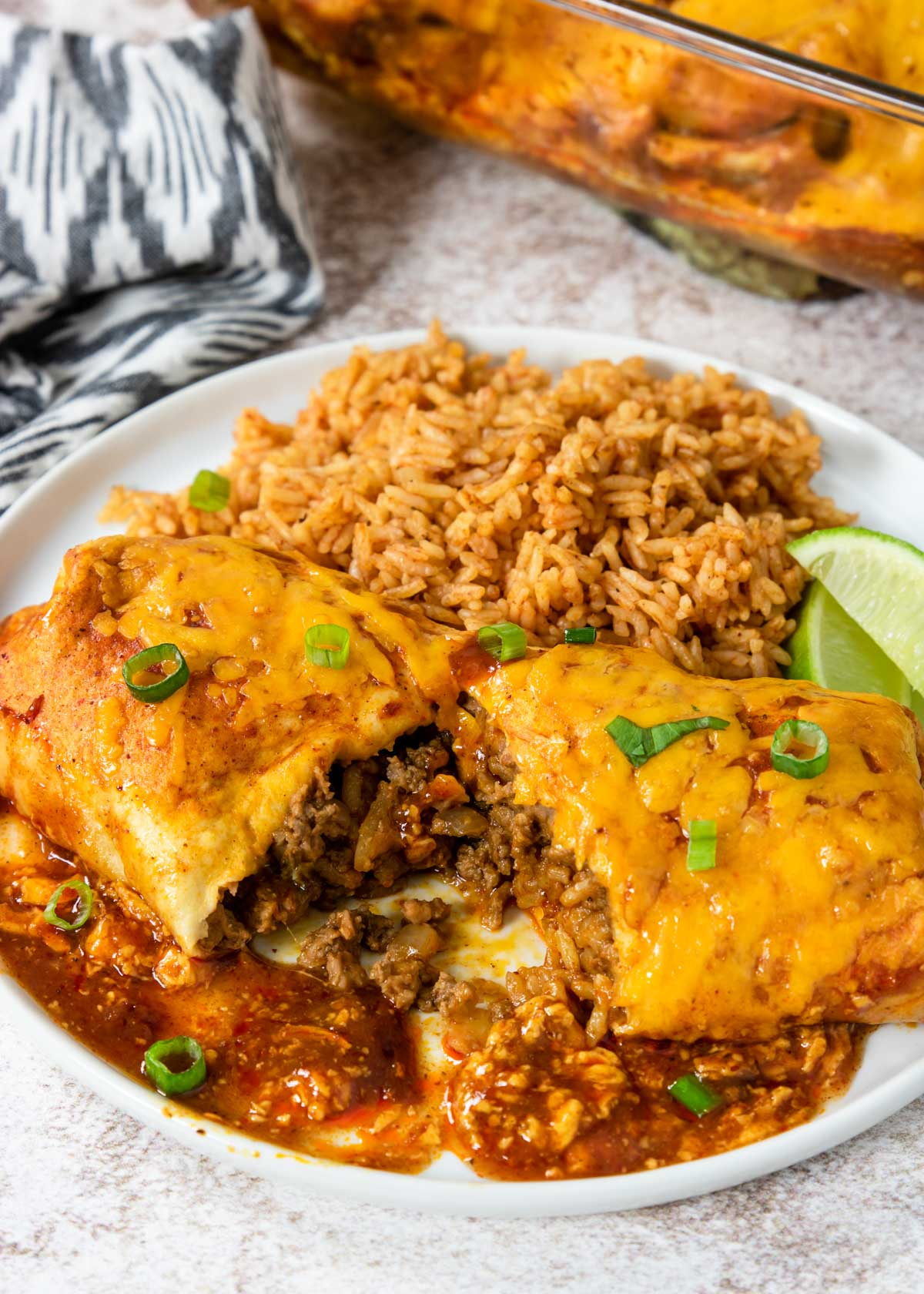 burrito cut in half with beans, rice and meat