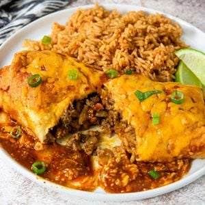 burrito on a plate with mexican rice