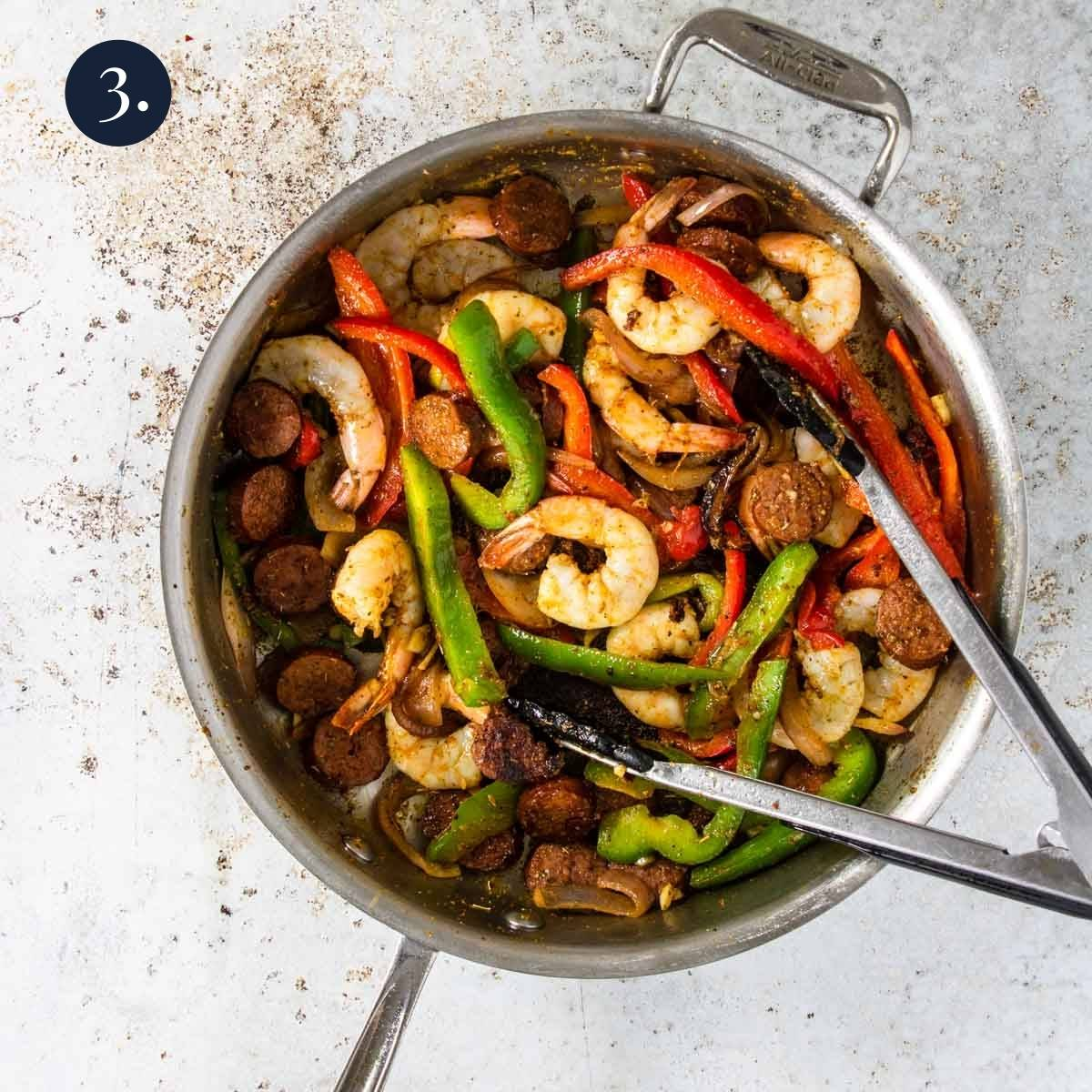 shrimp with peppers and onions in a skillet