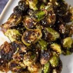 a plate with roasted brussels sprouts with sesame seeds