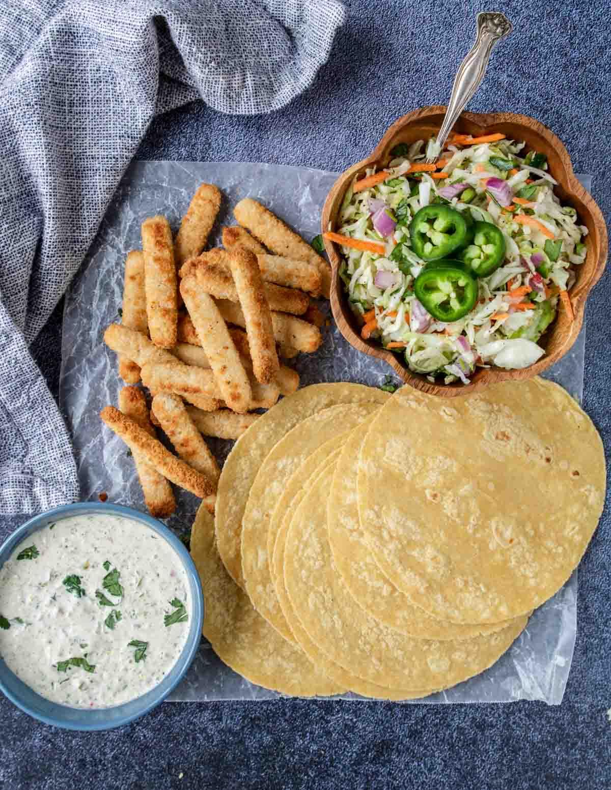 corn tortillas, fish sticks, slaw and tartar sauce