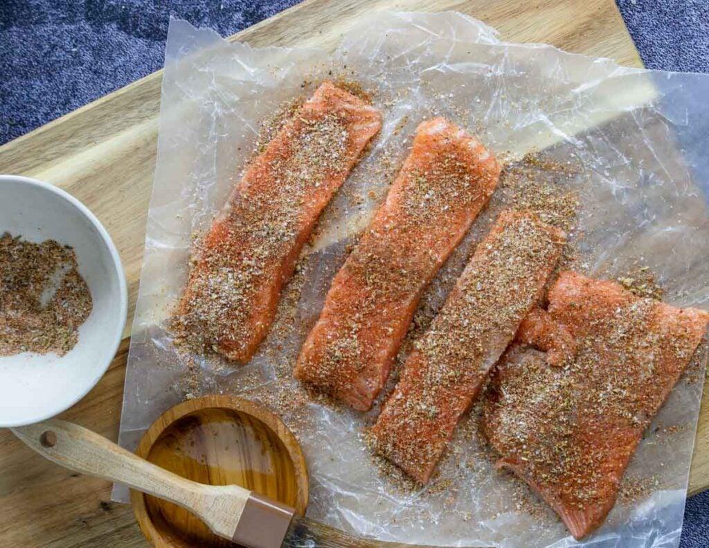 salmon fillets sprinkled with Cajun seasoning