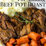 Beef Pot Roast on a platter with cooked carrots and mashed potatoes