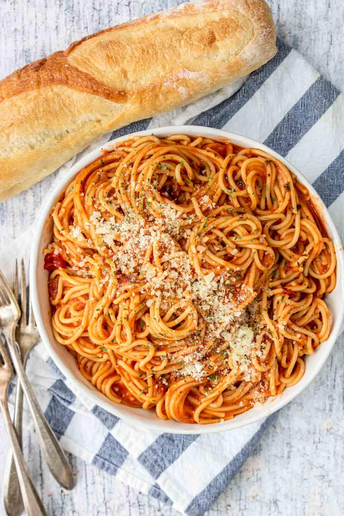 a big bowl of spaghetti with marinara