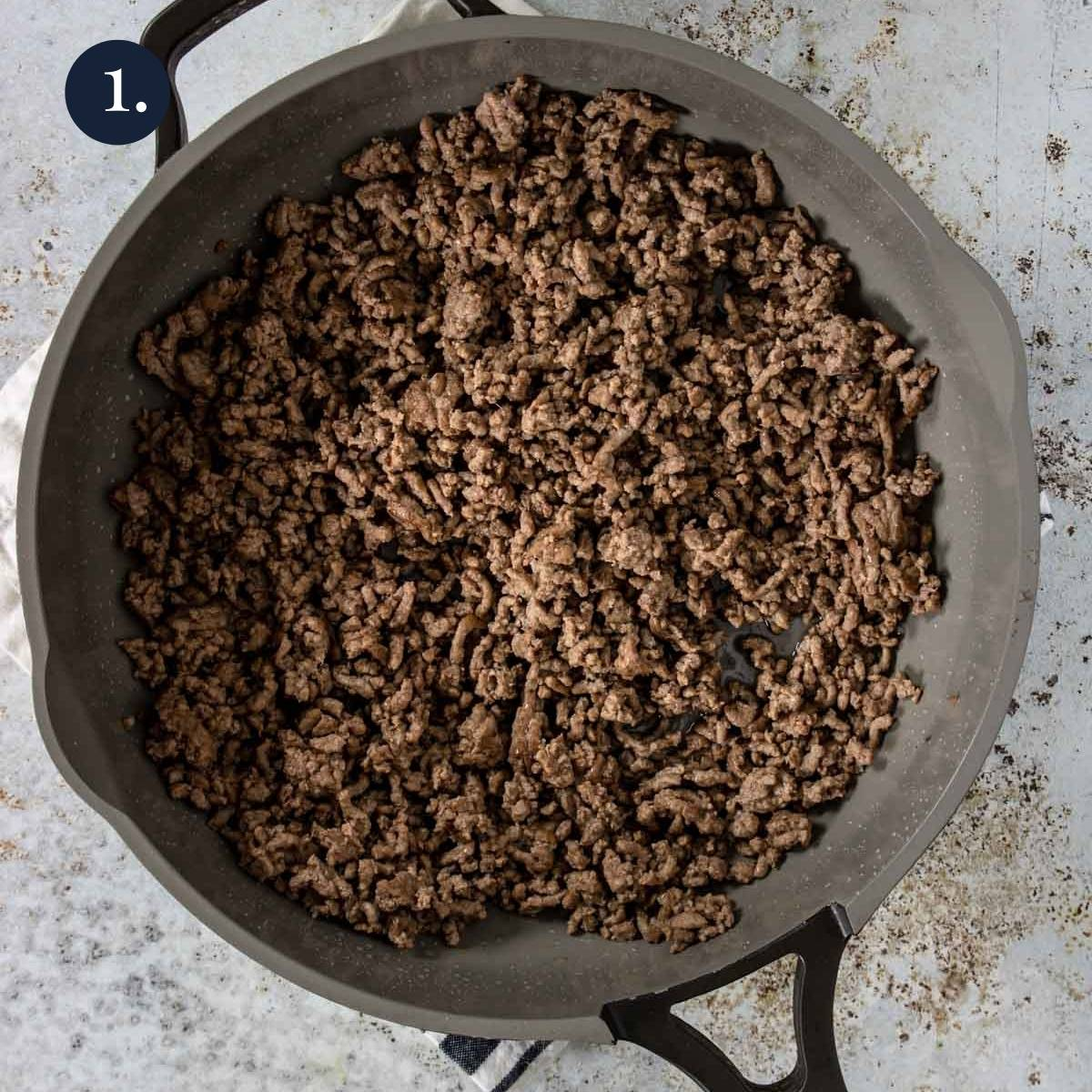 ground beef crumbled and cooked in a skillet