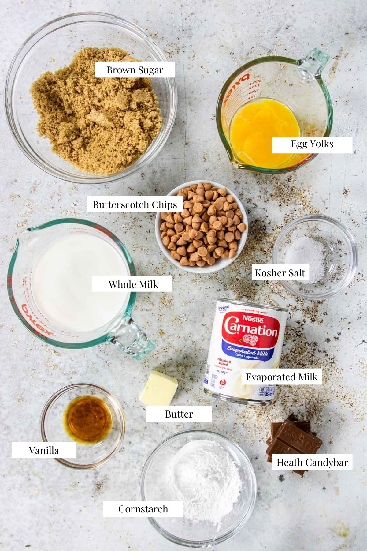ingredients to make butterscotch pudding on a table with labels