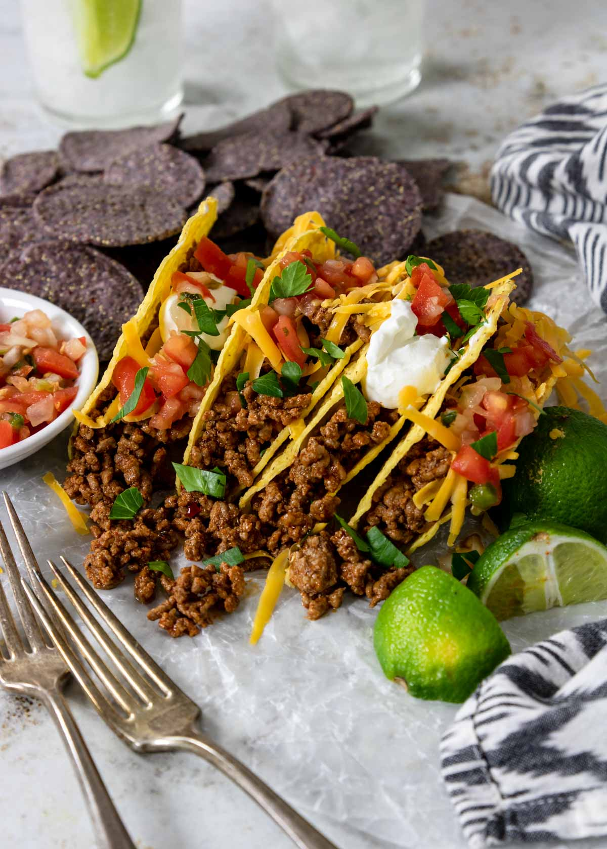 Ground beef tacos in hard shells with toppings