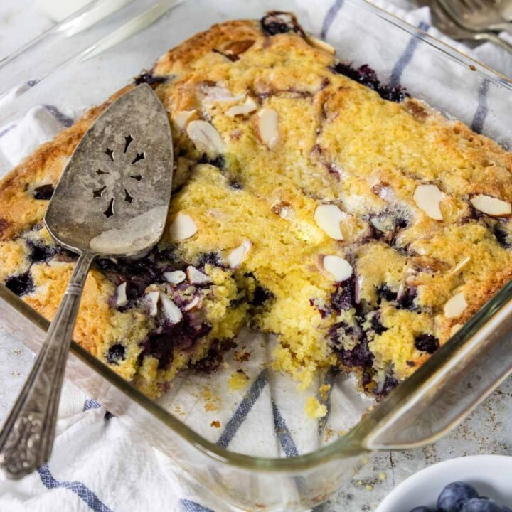 blueberry breakfast cake with a slice taken out.