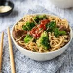 a bowl of Beef Ramen Noodles with broccoli and chili paste
