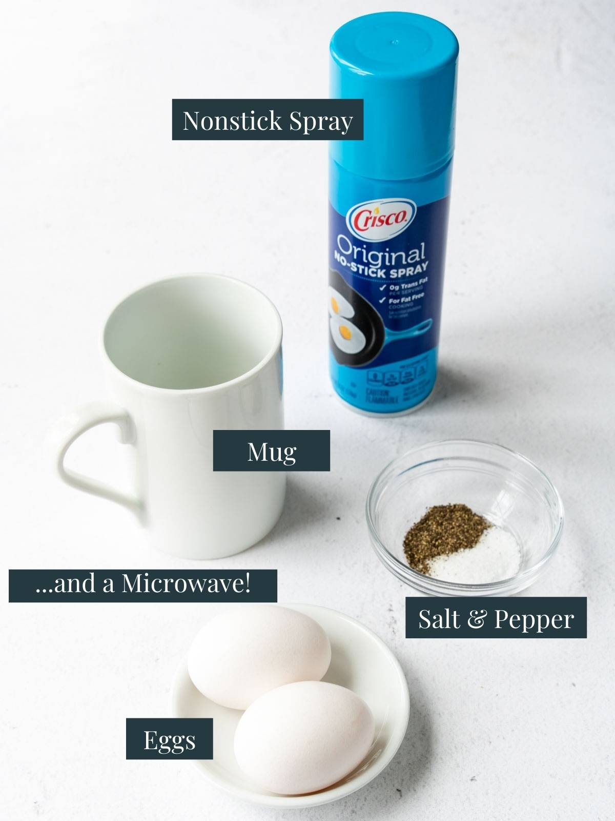 ingredients and supplies to make scrambled eggs in a mug and microwave
