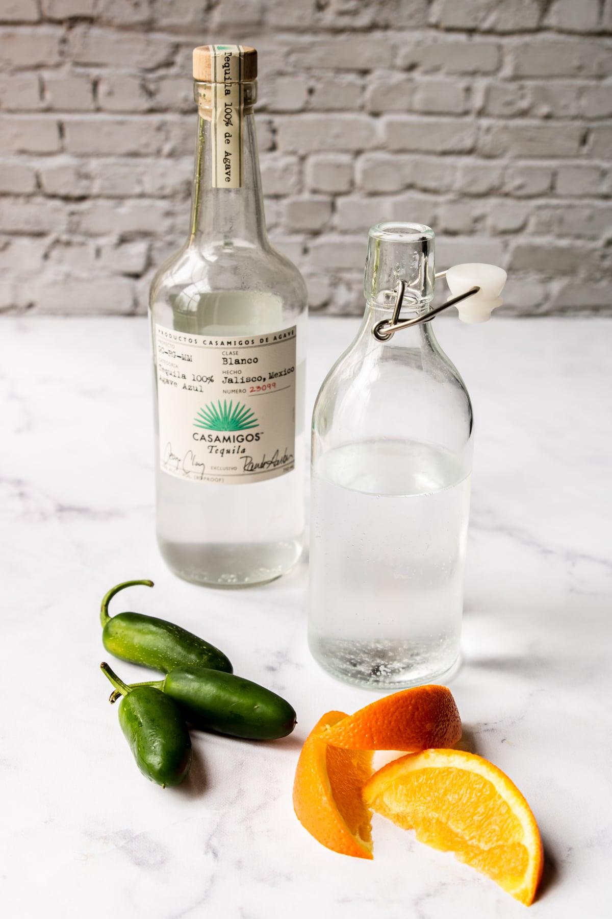 tequila, soda water, orange, and jalapeno