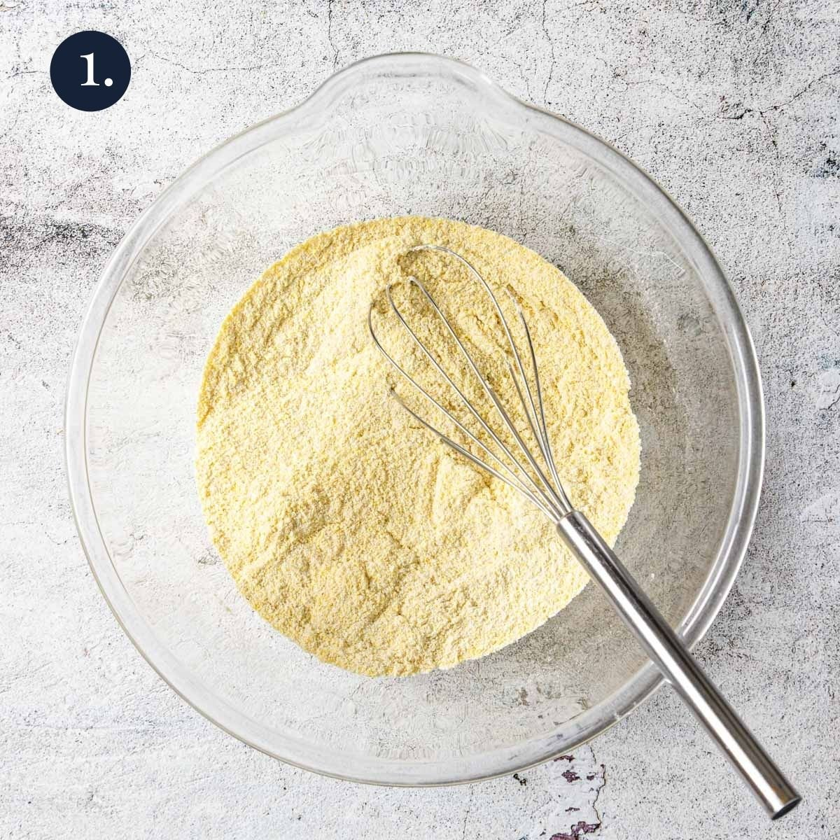 Dry ingredients mixed together in a bowl with a whisk