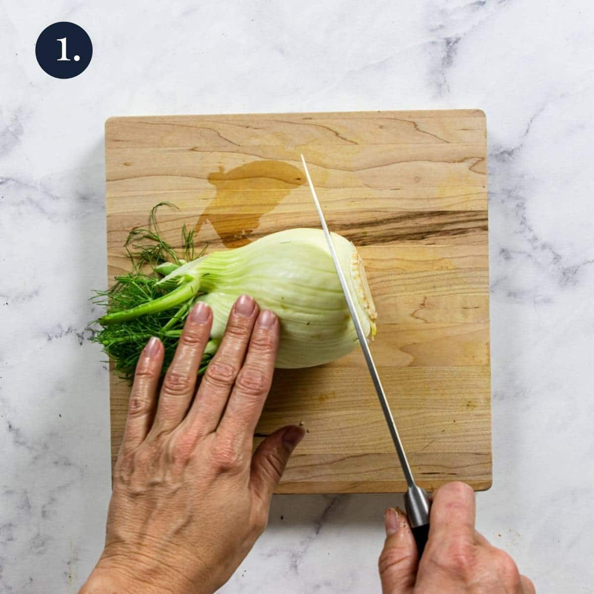 trimming the root end of fresh fennel