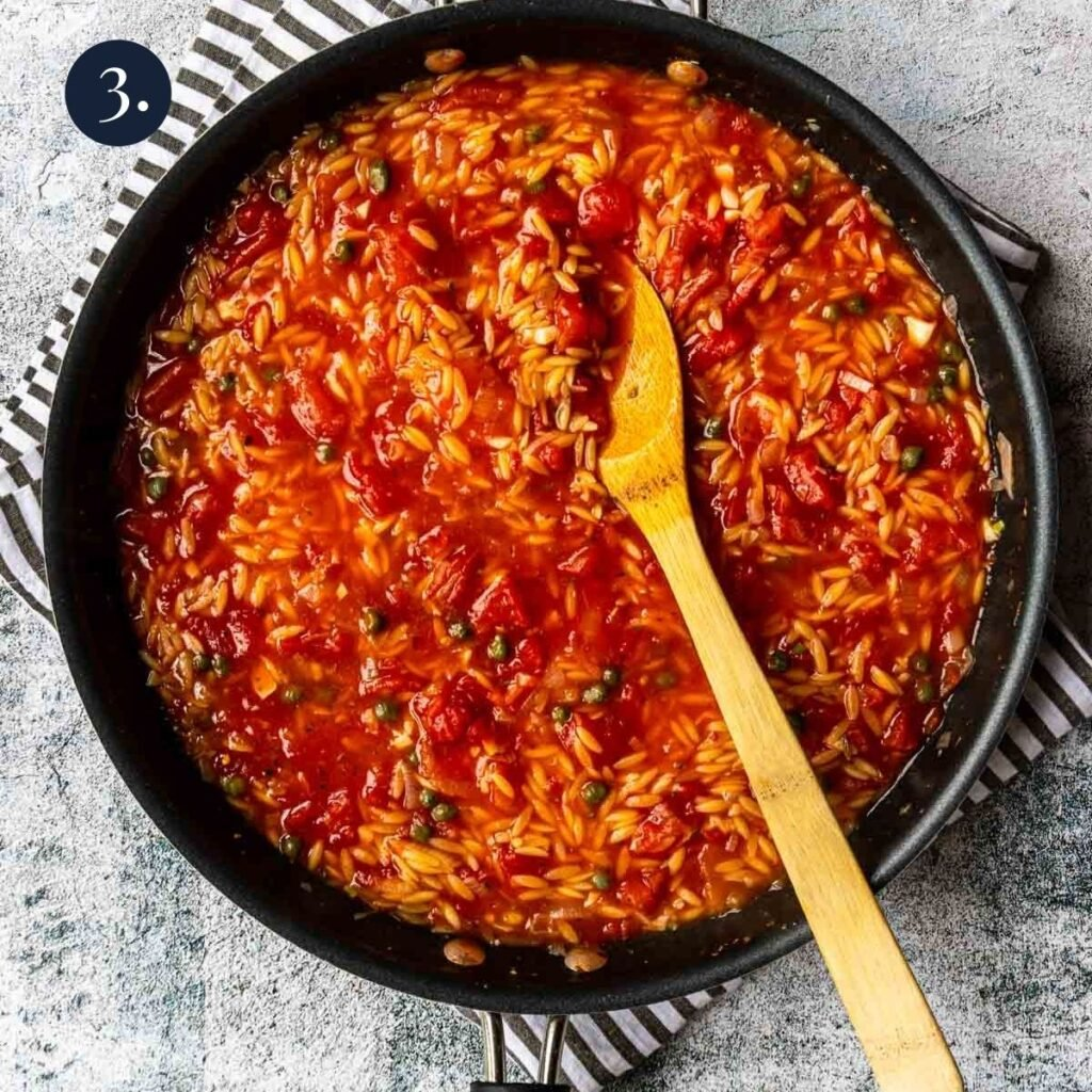 orzo that has been cooked in tomatoes and broth