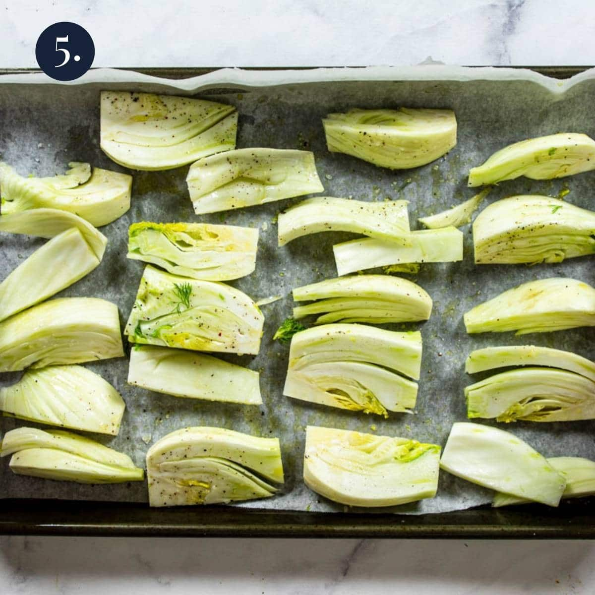 fennel wedges on a baking sheet lined with parchment