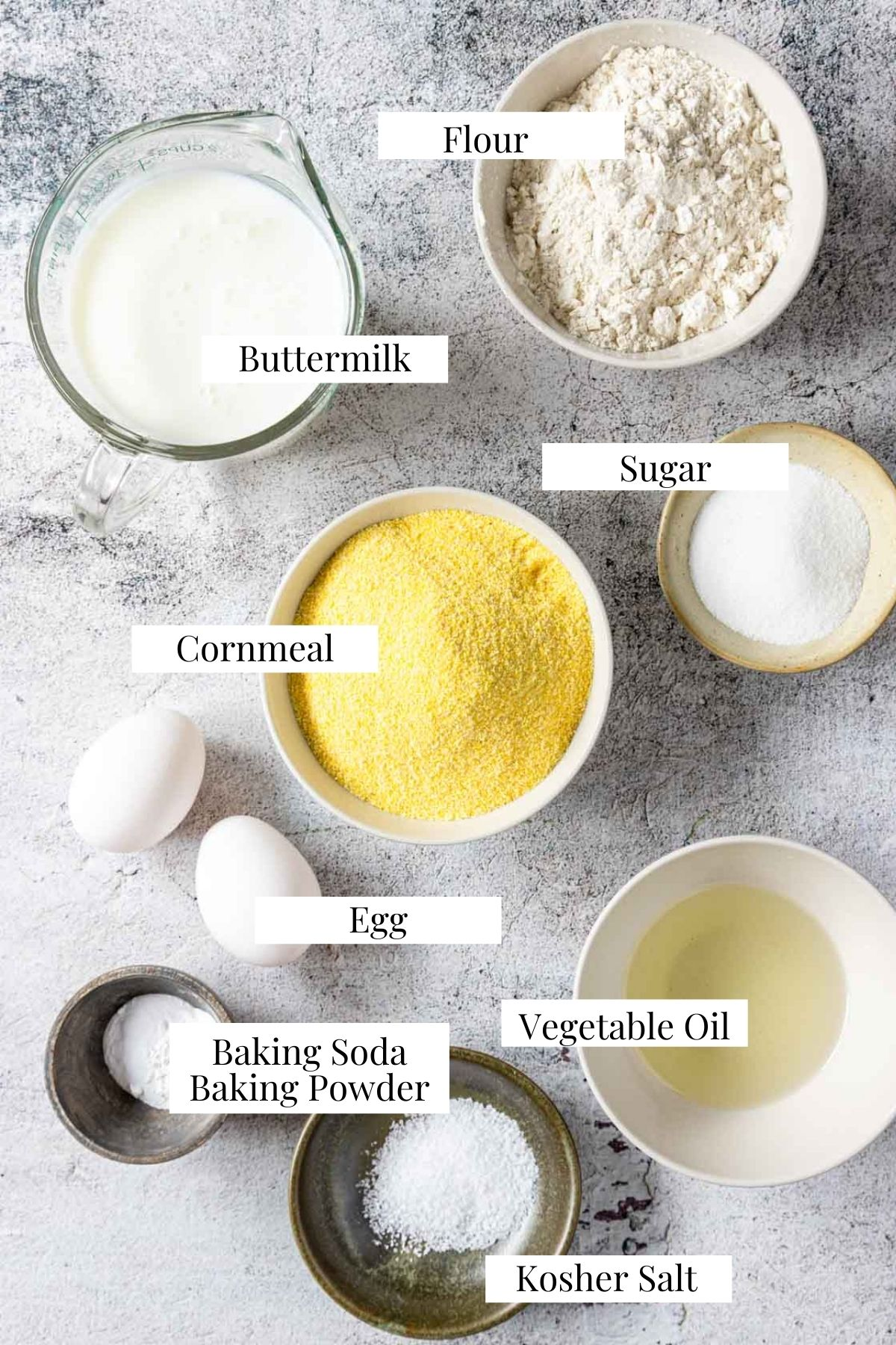 ingredients for cornbread on a table with text labels