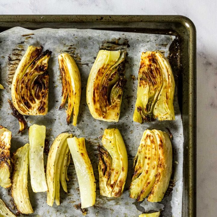 fennel that has been roasted on a baking sheet
