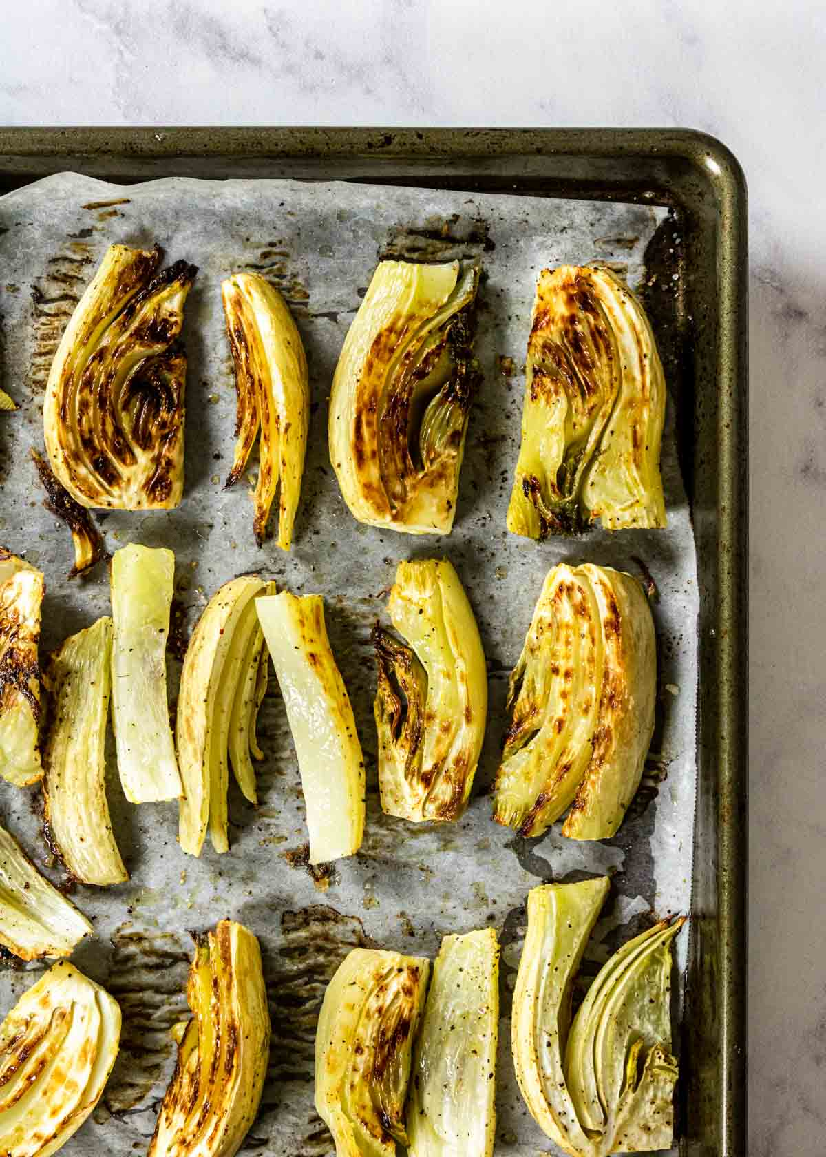 a sheet pan with roasted fennel