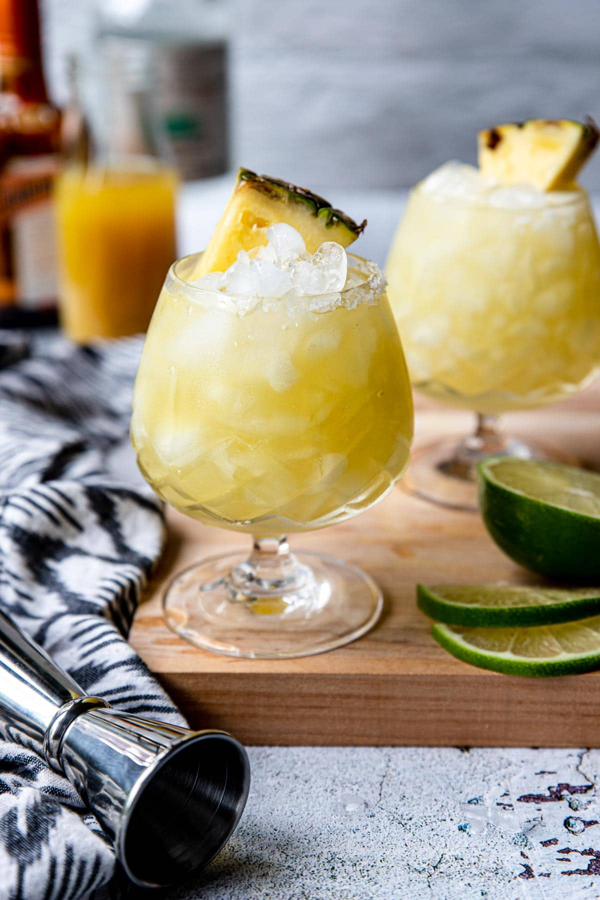 pineapple margarita in a fancy glass with a pineapple wedge on top