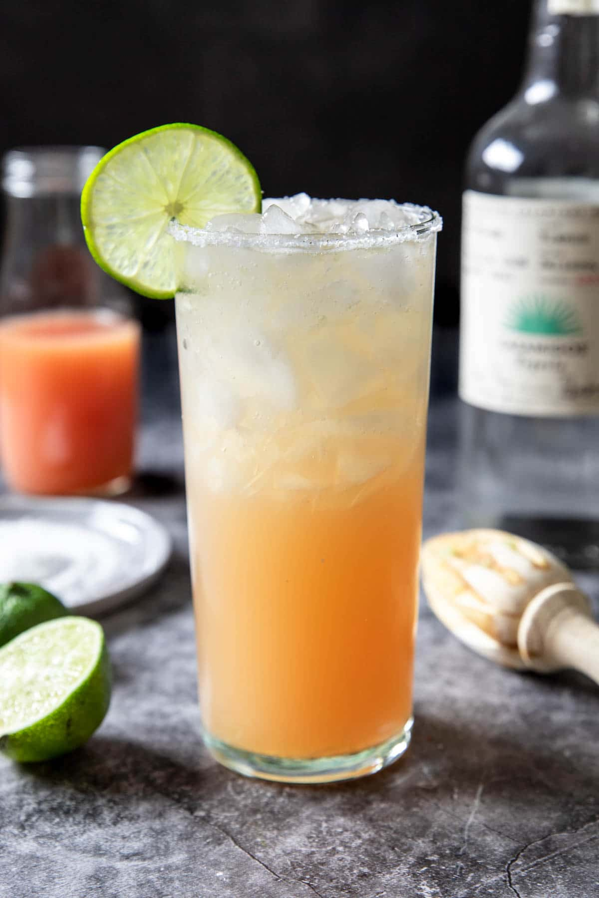Paloma in a tall glass with a lime on the side