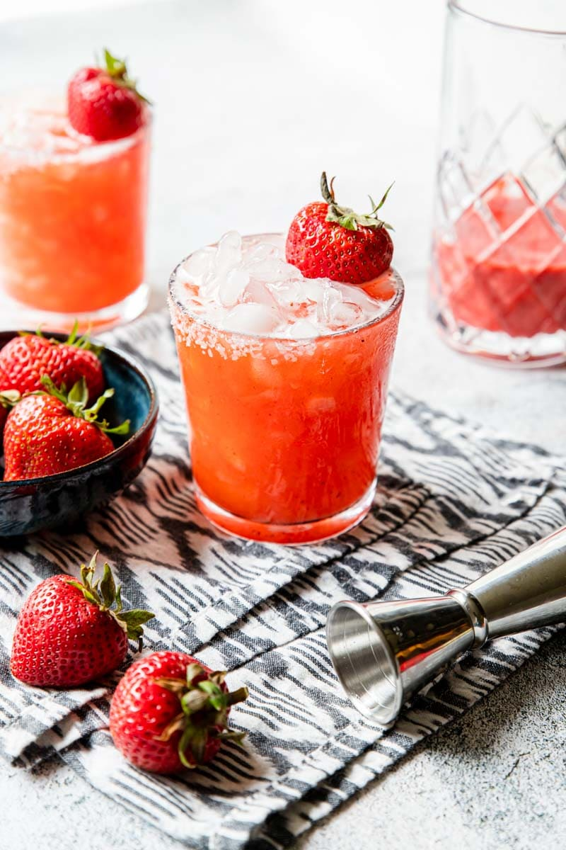 Roasted Strawberry margarita garnished with a strawberry