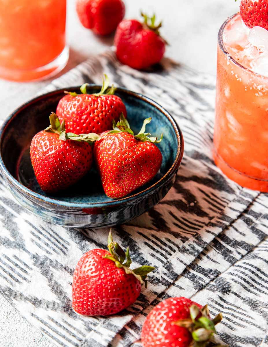 fresh strawberries with a strawberry margarita to the side