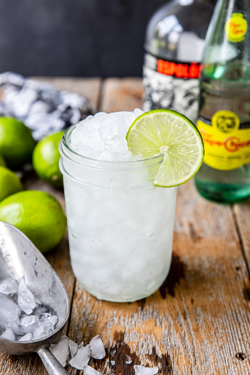 tequila ranch water in a glass with crushed ice and a lime wheel