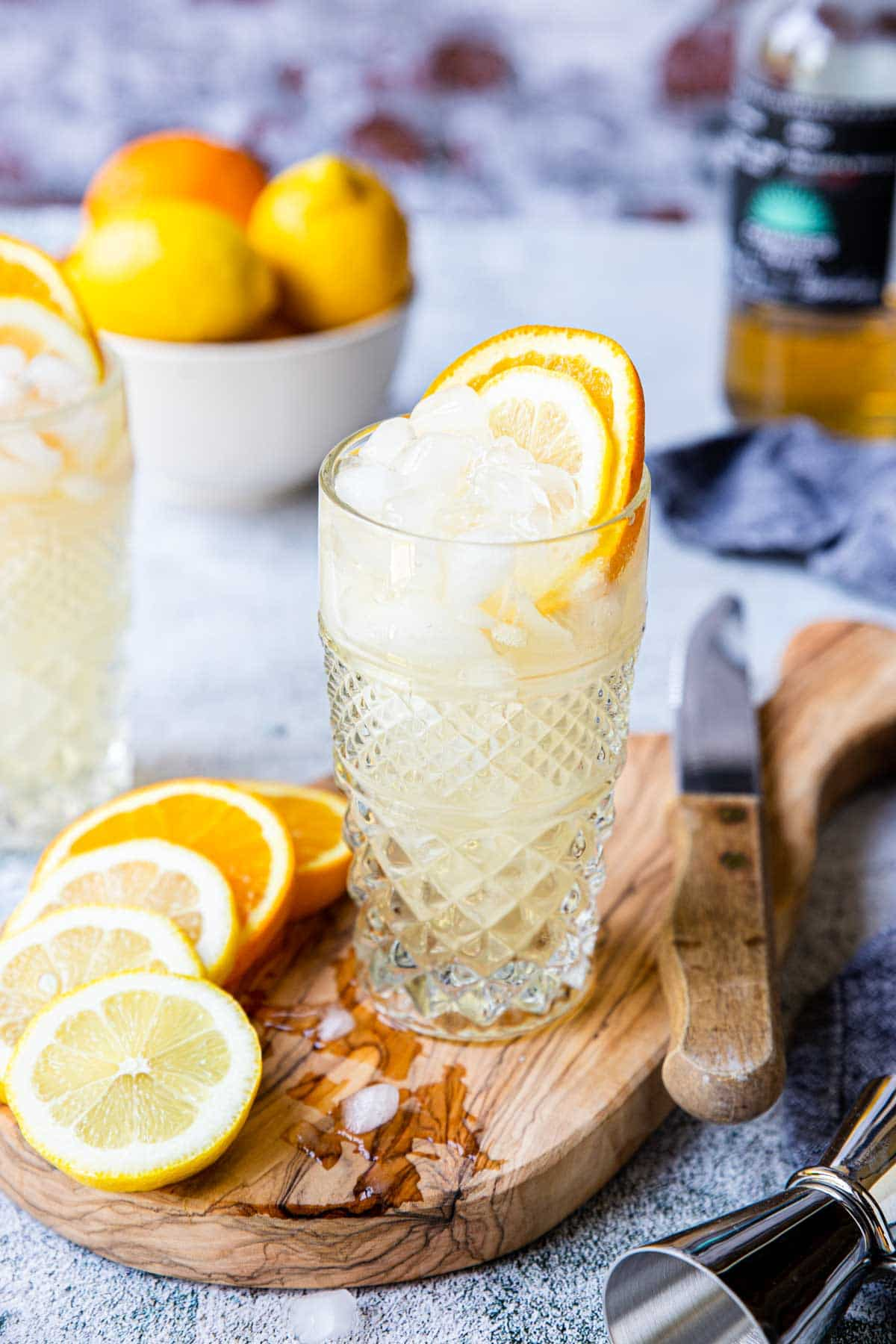 tequila cobbler in a glass garnished with lemon and orange wheel
