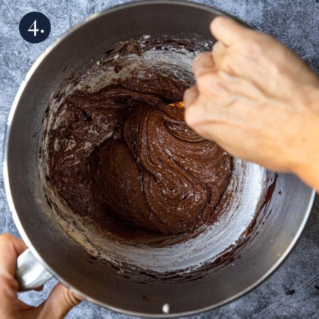 folding flour into a chocolate mixture