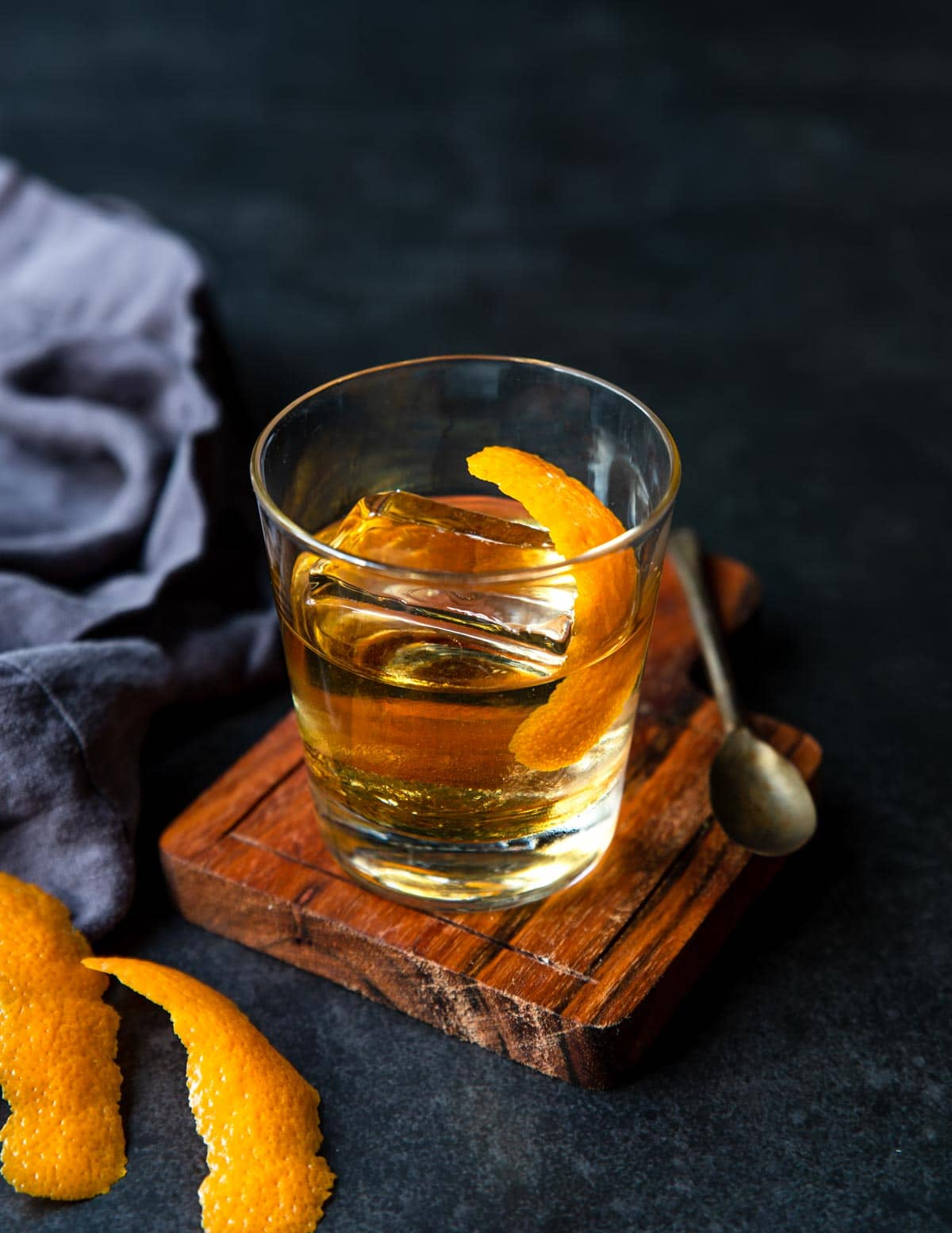 anejo old fashioned in a glass with clear ice