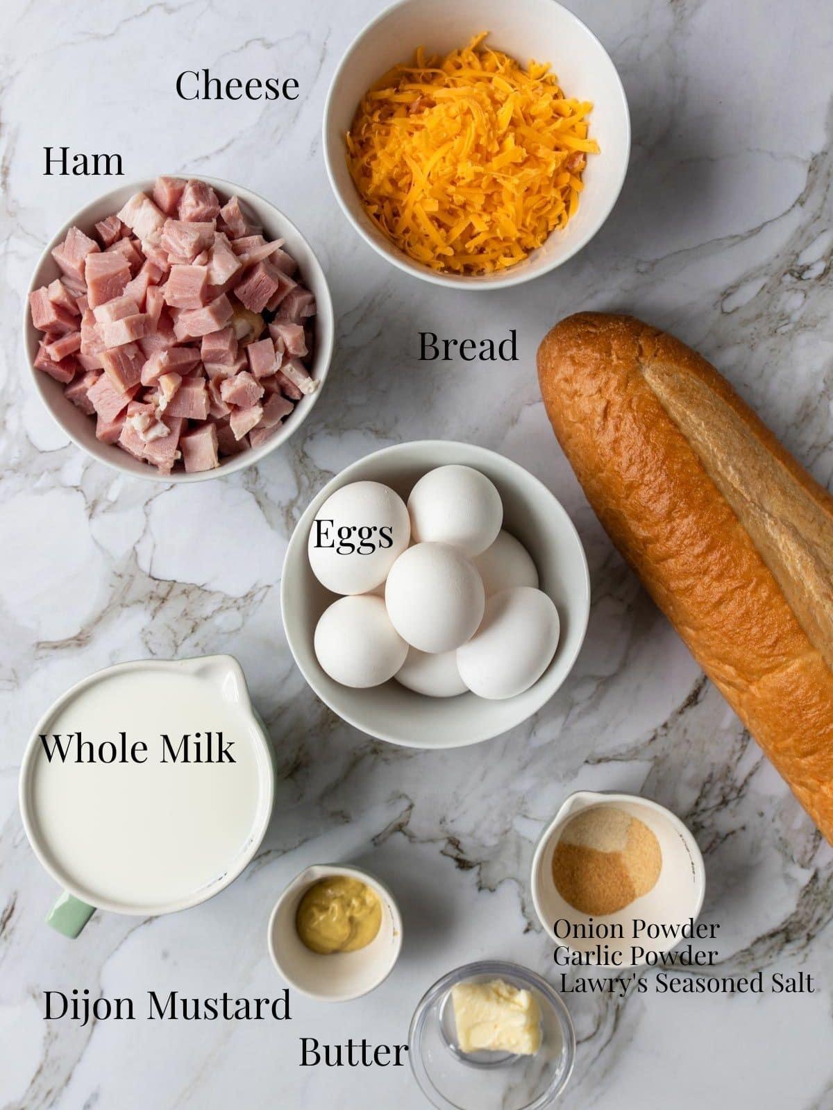 ingredients to make ham breakfast casserole with text