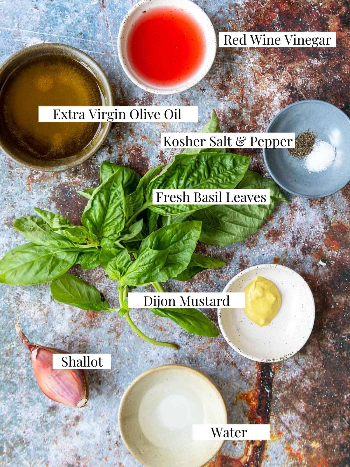 ingredients for basil vinaigrette with text labels