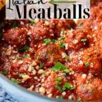 Italian Baked Meatballs in a pot of Marinara Sauce with Pinterest Text