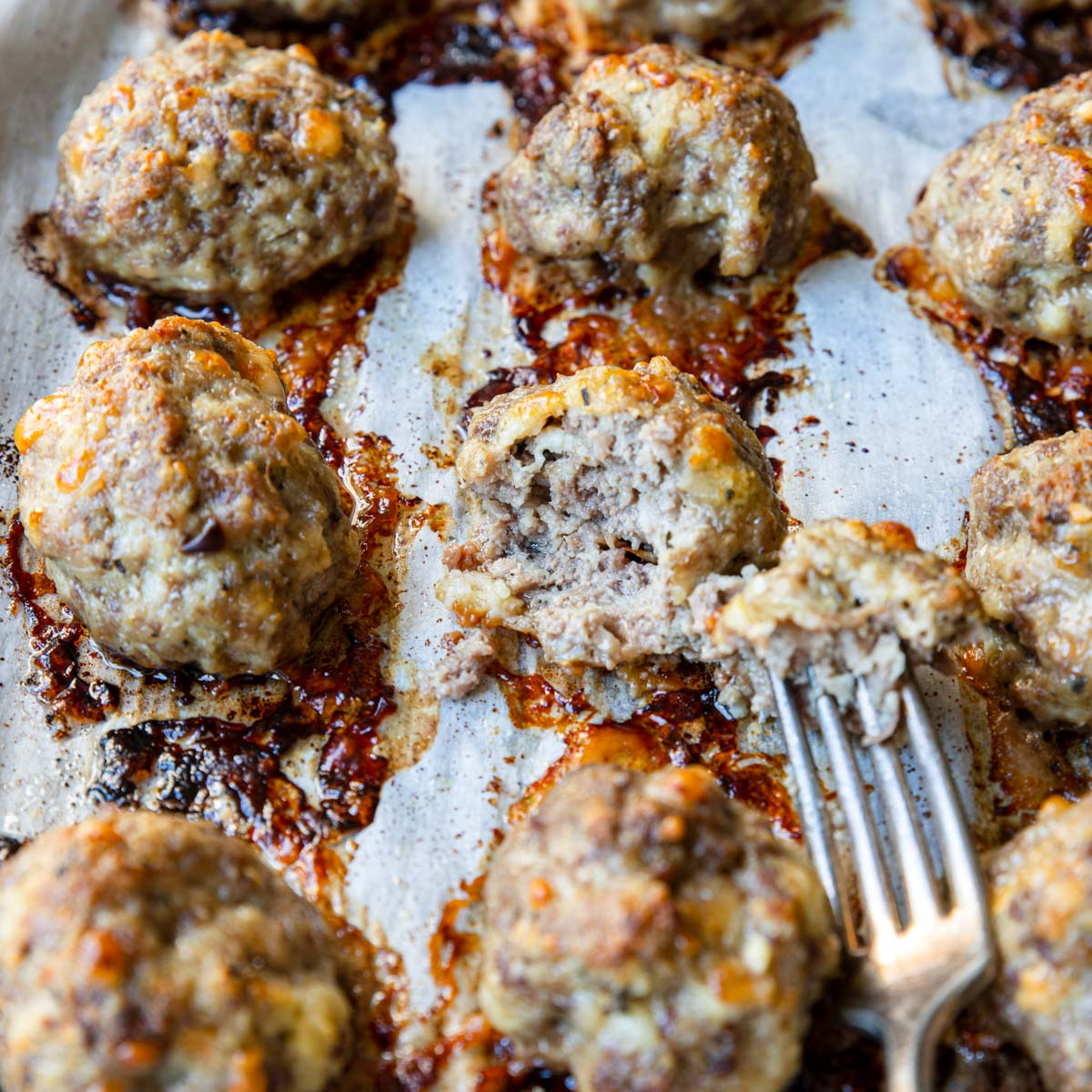 baked meatballs with one cut open